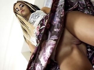 This sexy babe lifts her skirt just enough to show her pussy