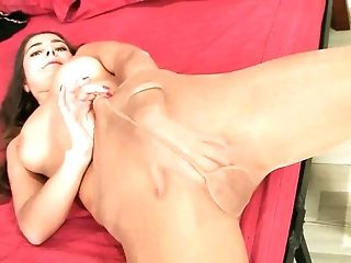 Straight haired hottie undresses and rubs her pussy through the pantyhose