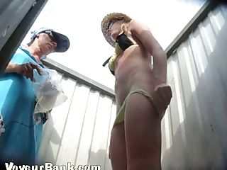 White chick and her hubby in the cabin changing her clothes after beach