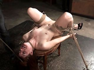 Caning the redhead on her legs and ass leaves a mark