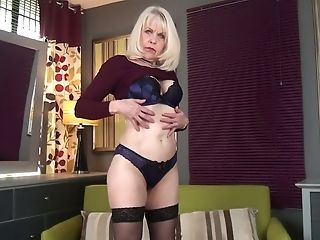 Old blonde with fake tits Margaret Holt gets naked and masturbates cunt