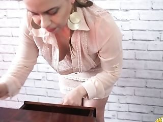 Young secretary Olga Cabaeva shows off off her sweet looking big boobies