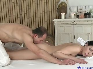 Needy babe fucks with the older masseur who's dick pleases her so much