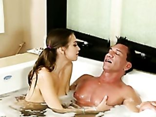 Pigtailed brunette chick Riley Reid swallows big thick cock when taking foaming bath