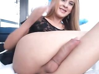 Horny Blonde Tranny Parades Her Huge Cock