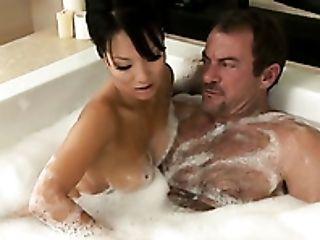 Sweet Asian lady Asa Akira seduces beefcake stud in bath