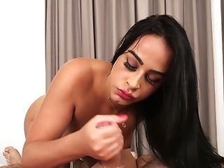 Alluring transsexual brunette Yasmine Santos is happy to blow delicious cock