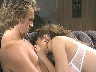 Christy Canyon dolls up for an amazing threesome session